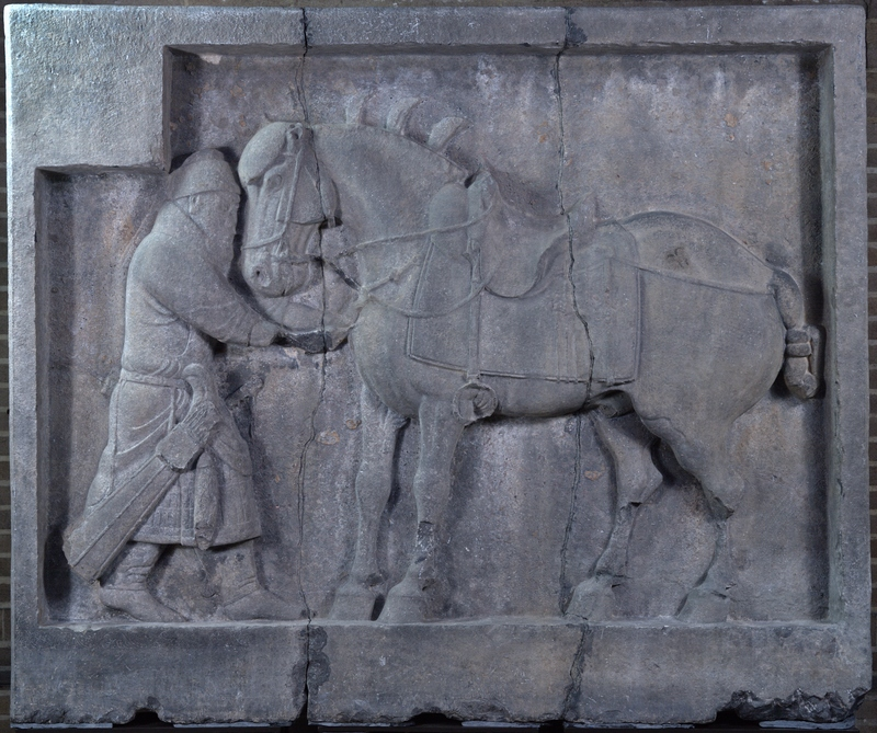 general pulling an arrow out of a horse's chest in relief