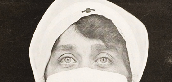 Black and white photo of nurses' face, eyes looking out from medical garments.
