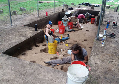 Photo of students excavating