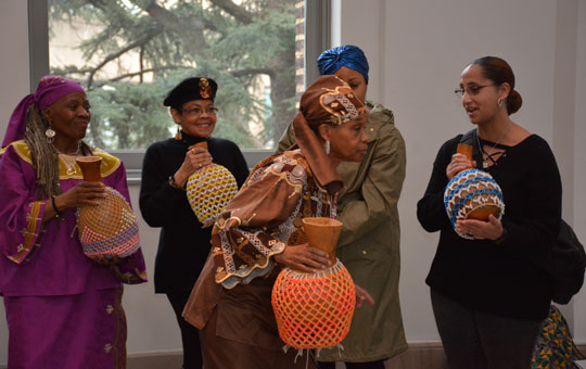 Women playing the sekere