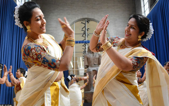 women doing a traditional dance in traditional garb