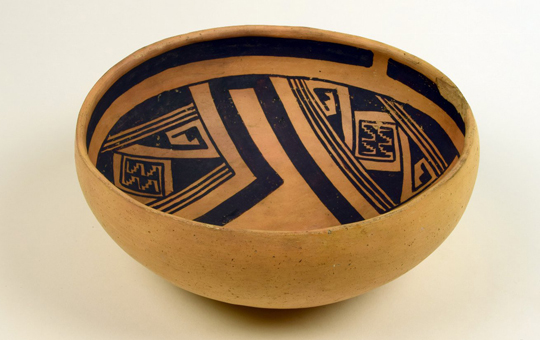A bowl with a stepped fret pattern painted on the inside.