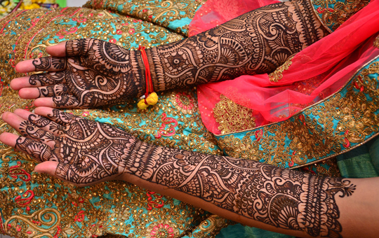 Hands and forearms covered in Mehendi