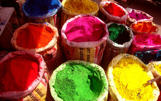 Large bags of colorfully dyed powder for Holi