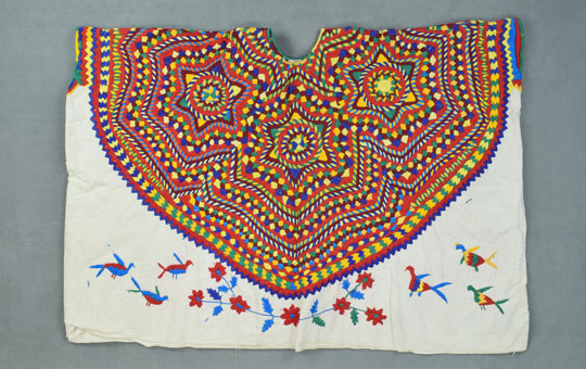 A brightly colored embroidered garment.