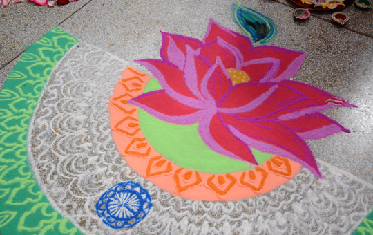 A chalk drawing of a lotus flower and design.