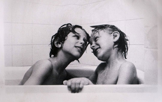 two brothers taking a bath together