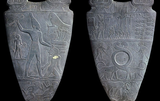 The front and back of the Narmer Palette depicting the unification of Upper and Lower Egypt.