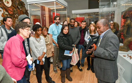 A Global Guide leading a tour in the Africa Galleries.