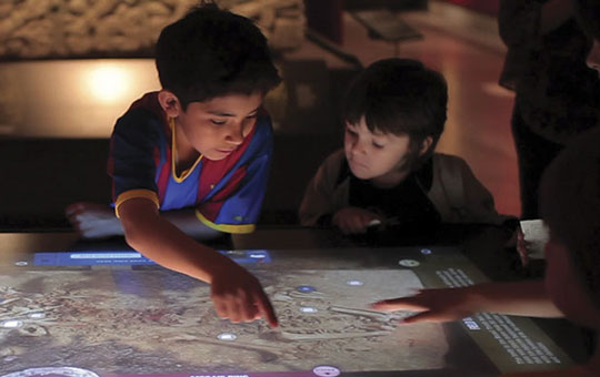 kids interacting with touch table