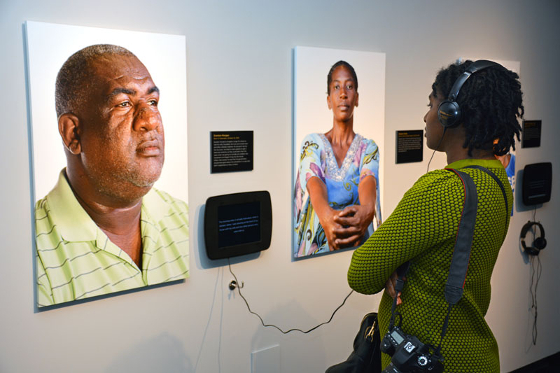 woman listening to an exhibit story