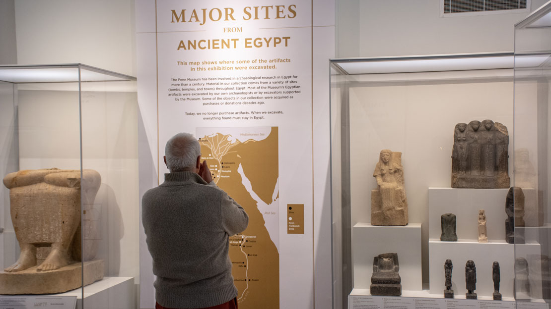 man reading about major sites in ancient egypt