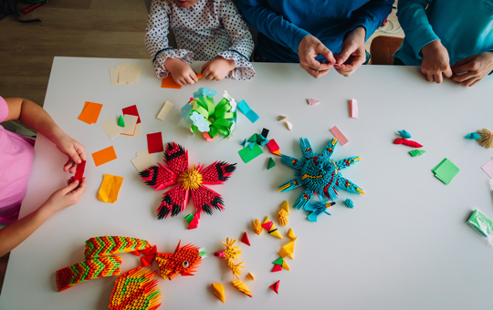 A family working on crafts together.