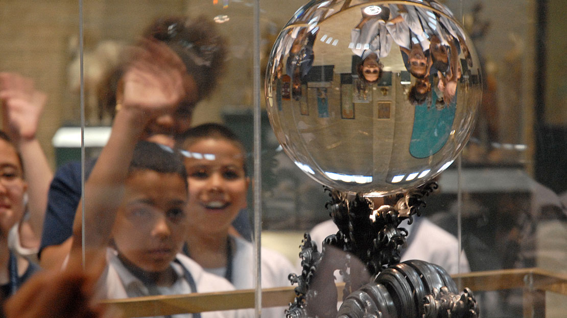 A group of students admiring the Crystal Ball.