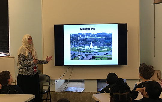 woman giving a presentation about damascus