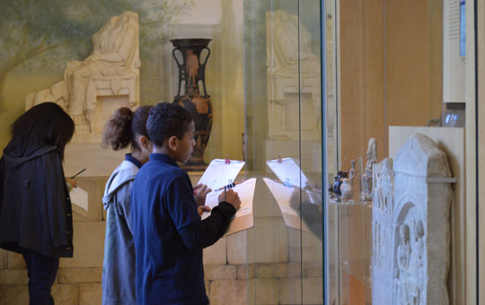 students doing a worksheet in a gallery