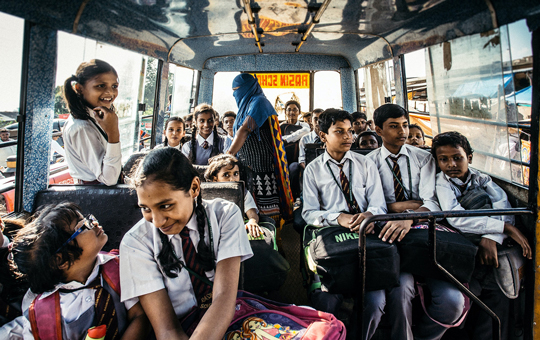 A group of school children on a bus.