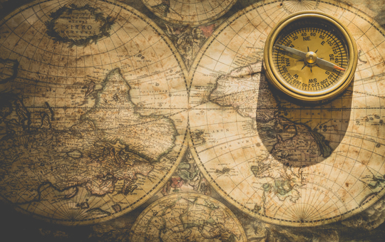 An old world map and a compass
