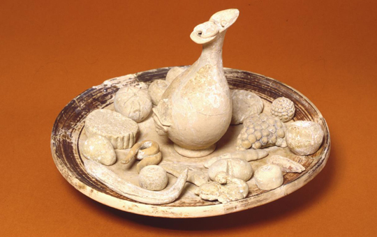 Ceramic offering depicting a platter of food and a pitcher