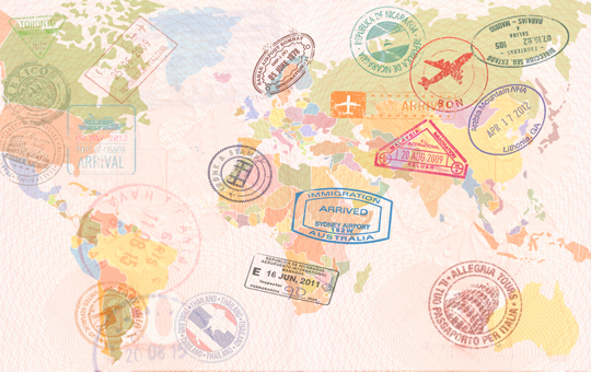 A world map covered in passport stamps.