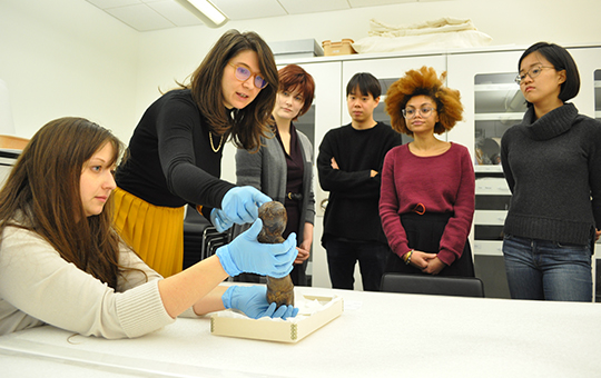 students in the archives learning about an artifact