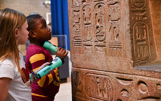 children examining heiroglyphs