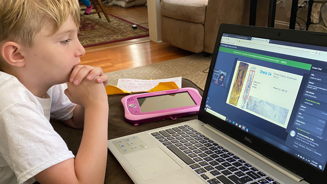A child attending a virtual At-Home Anthro Live session