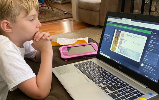 A child learning virtually
