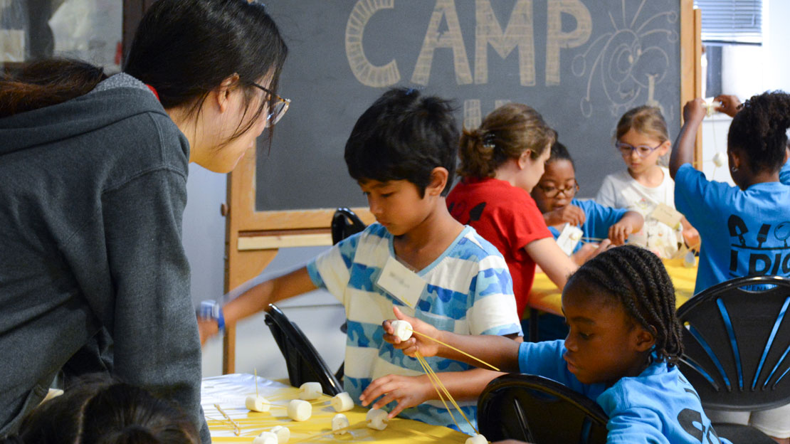 campers doing an activity with marshmallows