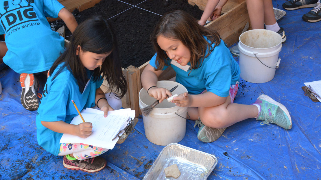 two children participating in a summer camp activity