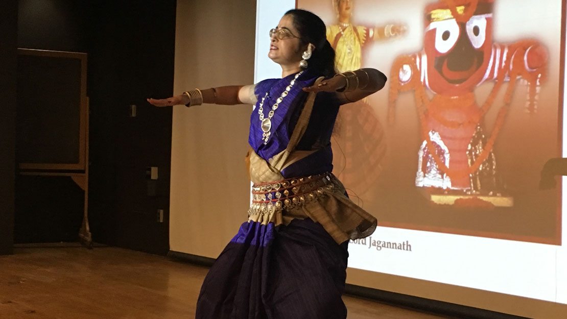 a woman performing a traditional dance