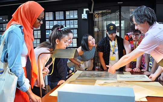 teen summer interns get a tour of museum archives by senior archivist alessandro pezzati