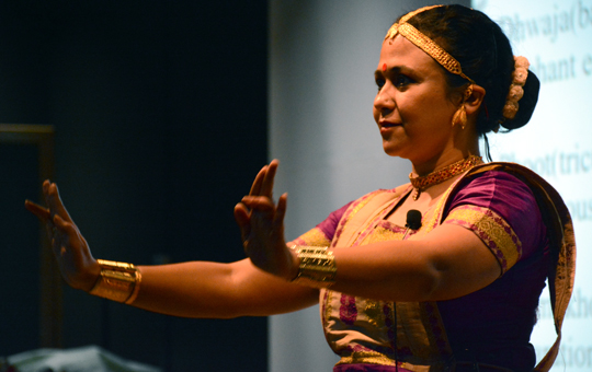 A woman performing a dance on stage